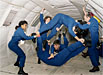 Astronaut candidates in a reduced-gravity aircraft