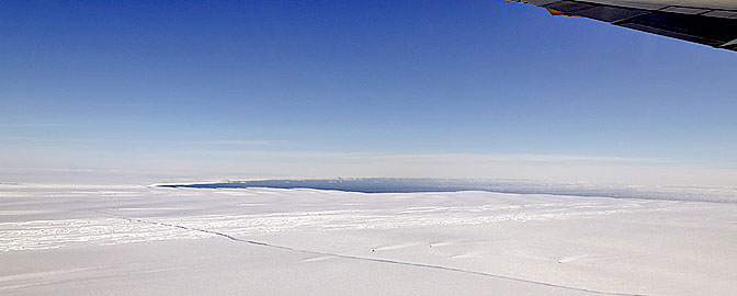 A large, miles-long crack was plainly visible across the ice shelf on the Pine Island Glacier during an overflight by NASA's DC-8 airborne science laboratory Oct. 14, 2011, as part of Operation IceBridge.