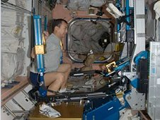 An astronaut performing exercise in the International Space Station. (JAXA/NASA)