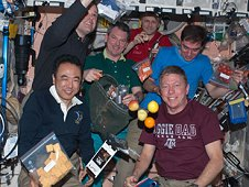 Astronauts enjoy meals in the International Space Station.