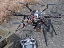 hexacopter on ground, with controller