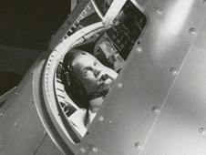 John Glenn (right) in the Mercury Procedures Trainer