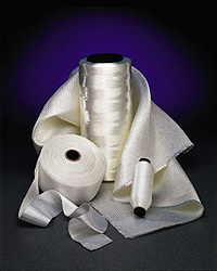 Spools of heat-resistant Nextel fabric.