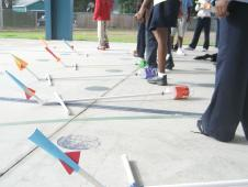 Students launching rockets at a NASA event