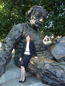 Marie Gleason-Tada with statue of Einstein