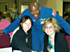 Marie Gleason-Tada (left) poses with Leland Melvin (center)