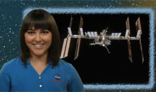A girl beside an image of the space station