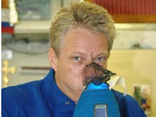 Former ESA astronaut Thomas Reiter undertaking science activities for the Nitric Oxide Analyzer (NOA) experiment in 2006. (ESA)