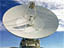 Color photo of a Deep Space Network 70-meter antenna. The dish alone is as large as a football field is long.