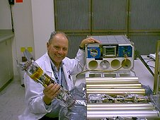 Dr. Morrison with MEPS flight hardware ready to pack for the International Space Station UF-2 mission. (NASA)