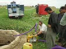 Volunteers help install and test a water purification system in Kendala, Iraq. (Concern for Kids)