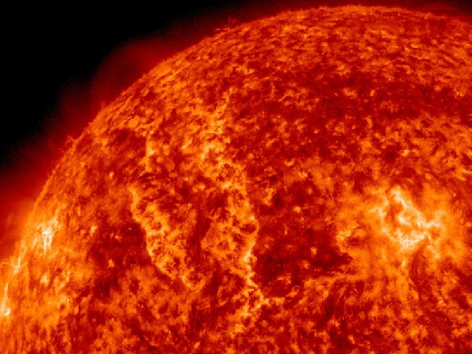 An erupting solar filament generates two large waves of plasma traveling in opposite directions.