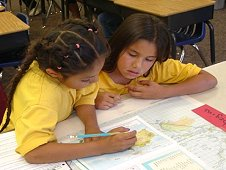 Third graders from Sacaton, Ariz., track the International Space Station for their EarthKAM project, just one of the educational benefits represented on the International Space Station Benefits for Humanity website. (NASA)