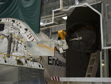 One of shuttle Endeavour's payload bay doors has been fully opened and an antenna retracted