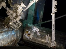 On July 12, 2011, spacewalking astronauts Mike Fossum and Ron Garan successfully transferred the Robotic Refueling Mission module from the Atlantis shuttle cargo bay to a temporary platform on the International Space Station's Dextre robot. (NASA)