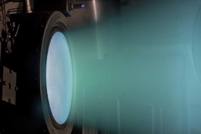 A NEXT engine fires at full power in a test chamber