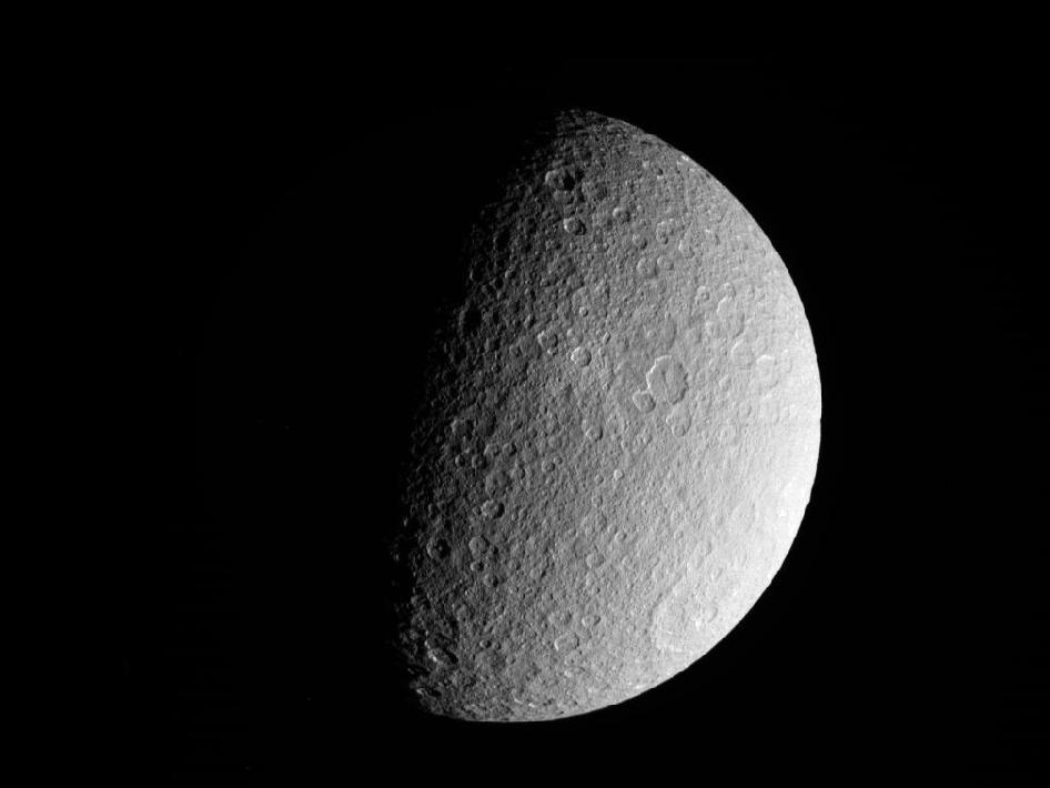 NASA's Cassini spacecraft took this raw, unprocessed image of Saturn's moon Rhea on March 10, 2012