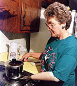 Photograph of a woman cooking with a prosthetic arm