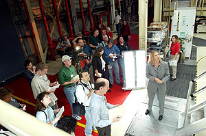 Members of the media being briefed on the modifications to Shuttle Discovery.