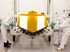 The James Webb Space Telescope's Engineering Design Unit primary mirror segment, coated with gold by Quantum Coating Incorporated.