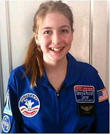A girl in a blue Space Camp flight suit