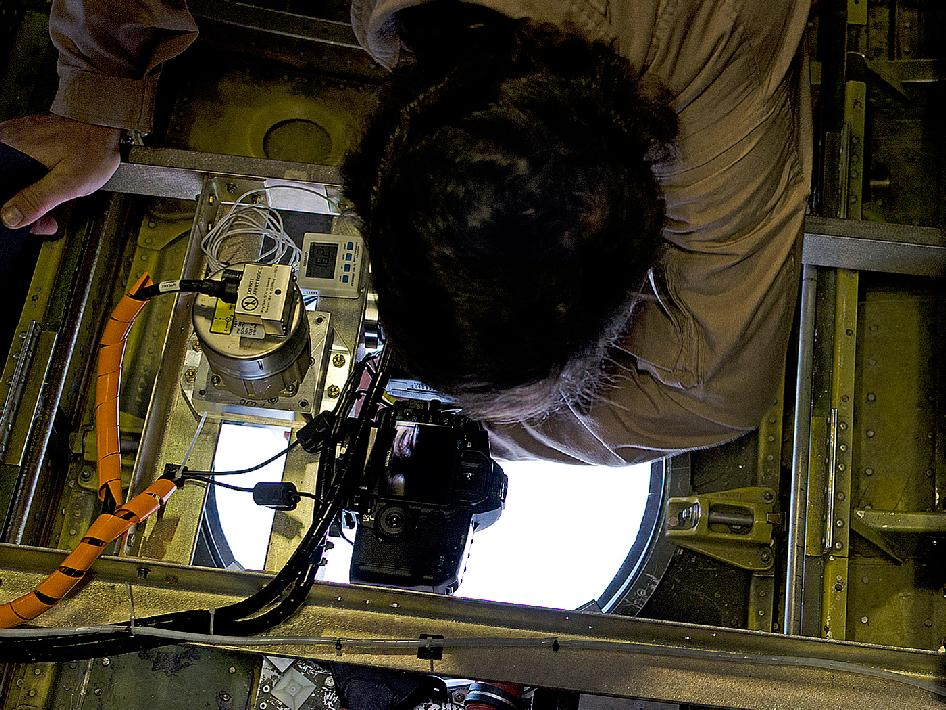A team member cleans the optical window prior to a flight.