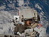 Astronaut Steve Swanson spacewalking with Earth in background