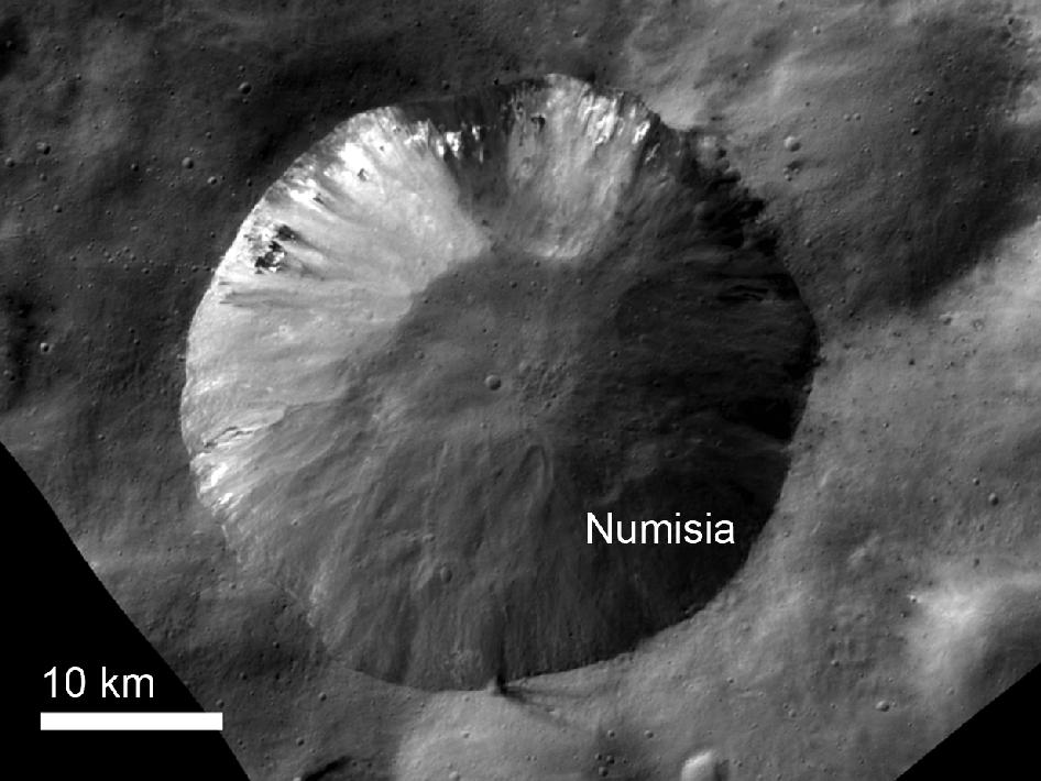 This image from NASA's Dawn spacecraft shows the crater Numisia, located just south of the equator in the Numisia quadrangle on Vesta.