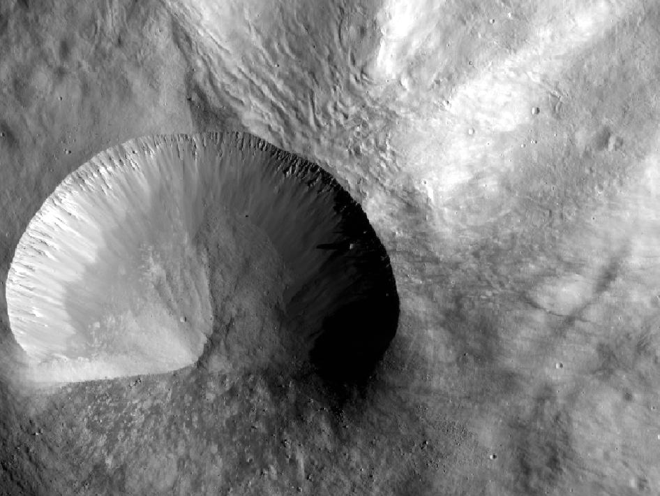 This image from NASA's Dawn spacecraft shows a young crater on Vesta that is 9 miles (15 kilometers) in diameter.