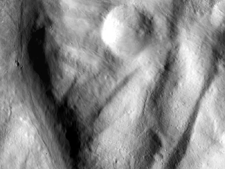 This image, from NASA's Dawn spacecraft, shows rock material that has moved across the surface and flowed into a low area in the ridged floor of the Rheasilvia basin on Vesta.