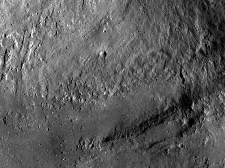 This image from NASA's Dawn spacecraft shows an interior wall and southern terrace of Marcia crater on Vesta.