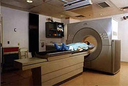 A person laying on the table of an MRI machine