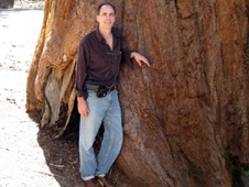 Duane Waliser leaning against a large sequoia tree
