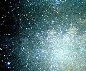 Perseid meteor shower streaking through the night sky full of stars