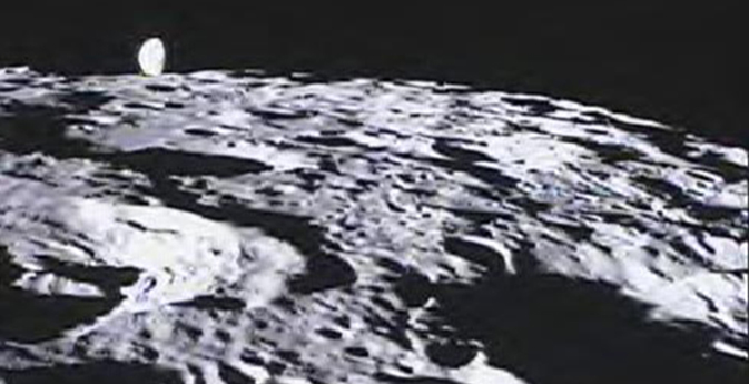Far side of the lunar surface with Earth in the background
