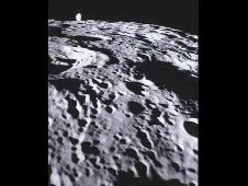 Far side of the lunar surface, with Earth in the background