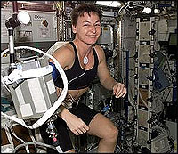 Female astronaut exercising surrounded by machinery