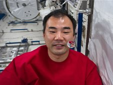 Japan Aerospace Exploration Agency astronaut Soichi Noguchi watches a water bubble float freely between him and the camera the Kibo laboratory. (NASA)