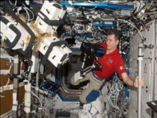 European Space Agency astronaut Paolo Nespoli, Expedition 27 flight engineer, works with Anomalous Long Term Effects on Astronauts (ALTEA-Shield) equipment in the Destiny laboratory of the International Space Station. (NASA)