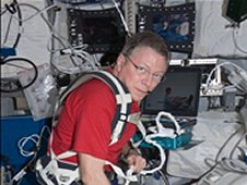 NASA astronaut Mike Fossum, Expedition 29 commander, performs a Sprint leg muscle self scan in the Columbus laboratory of the International Space Station. (NASA)