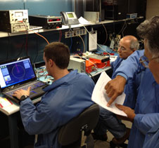 NASA Dryden engineers and technicians bench-check the ADS-B unit and software interface.