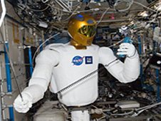 On March 14, 2012, controlled by teams on the ground, Robonaut 2 humanoid robot holds an instrument to measure air velocity during a system check out in the Destiny laboratory of the International Space Station. (NASA)