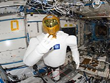 "A fisheye lens attached to an electronic still camera was used to capture this image of Robonaut 2 humanoid robot during another system checkout in the Destiny laboratory of the International Space Station. Teams on the ground commanded Robonaut through a series of dexterity tests as it spelled out ""Hello world"" in sign language. (NASA)"