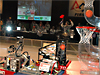 Robots on a basketball court during the FIRST Robotics competition