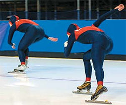 Picture of two male ice skaters racing