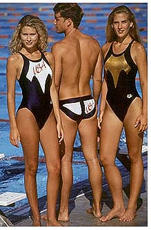 Two women and a man modeling swimsuits