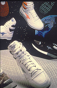 Several tennis shoes floating around as if in space