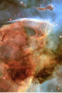 The murky, auburn tones of the Keyhole Nebula.