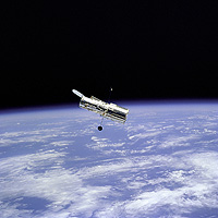 The Hubble Space Telescope gliding above the Earth.