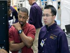 NASA engineer and Prairie View A&M graduate Cecil Shy talks with Prairie View senior Toan Nguyen in